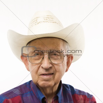 Portrait of elderly man in cowboy hat.