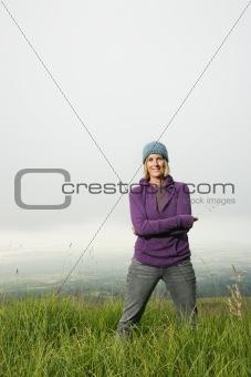 Caucasian woman in field.