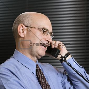 Caucasian businessman on telephone.