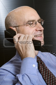 Caucasian businessman on telephone.