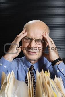 Caucasian businessman stressing.
