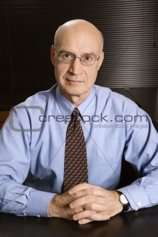 Caucasian businessman at desk.