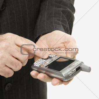 Caucasian businessman using PDA.