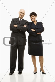 Smiling businessman and woman.