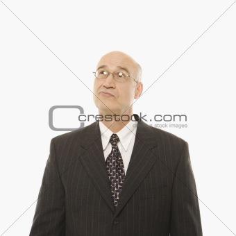 Caucasian businessman looking confused.