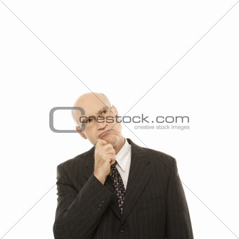 Caucasian businessman looking thoughtful.