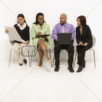 Multi-ethnic business group sitting.