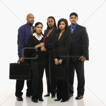 Business group of men and women standing with briefcases.