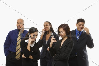 Business group of men and women talking on cell phones.