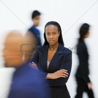 Businesswoman portrait with others. walking by.