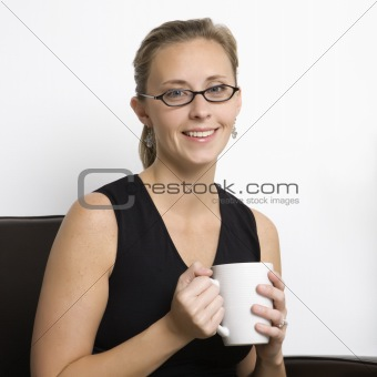 Caucasian woman portrait with coffee cup.