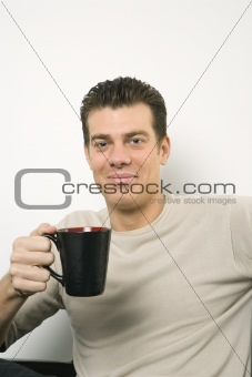 Caucasian male portrait with coffee cup.