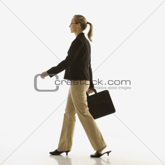 Businesswoman walking with briefcase.
