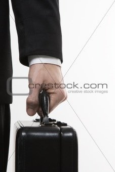 Businessman's hand holding briefcase.