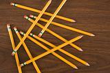 Bird's eye view of wooden pencils scattered on desktop.
