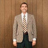 Portrait of smiling man in retro suit