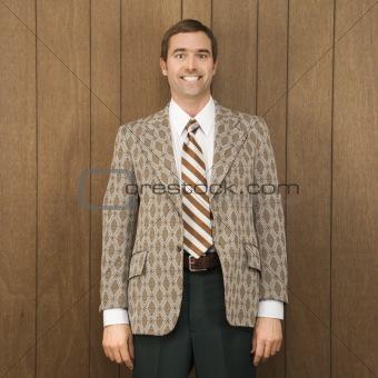 Portrait of smiling man in retro suit