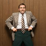 Man in retro suit pulling up pants.