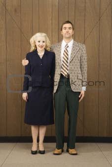 Man in retro suit with arm around woman.