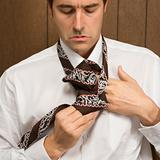 Man tying his necktie.