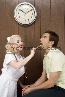 Female nurse examinating man's mouth.