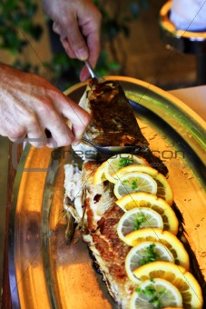 Fish with a lemon at restaurant