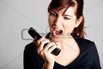 Unhappy woman at cellphone
