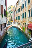 Canal in Venice and Restaurant