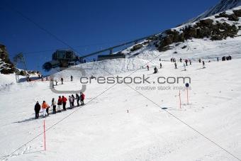 Skiers on alpine ski slope