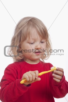 boy with long blond hair and toothbrush - isolated on white