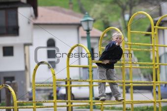 blonde boy in park