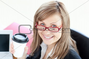 Beautiful businesswoman drinking coffee