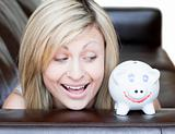 Happy woman using a piggybank
