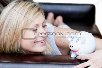 Positive woman using a piggybank