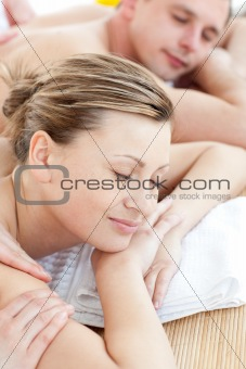 Caucasian couple having a massage