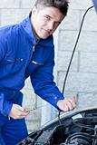 Confident man repairing a car
