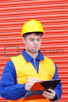 Handsome male engineer writing his report