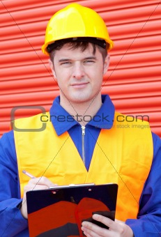 Caucasian male engineer writing his report