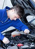 Self-assured man repairing a car