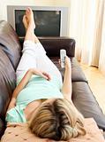 Beautiful woman using a remote