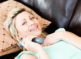 Happy woman using a remote