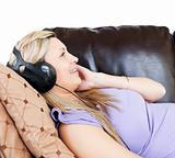 Relaxed woman using headphones