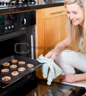 Beautiful housewife preparing cookies