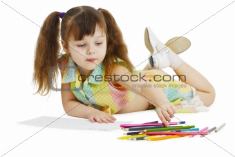 Little girl draws with crayons