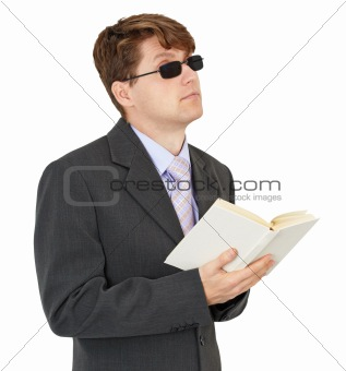 Blind young man with book isolated on white background