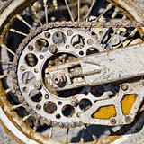 Rear wheel of motorcycle with chain covered with dirt