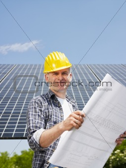electrician standing near solar panels