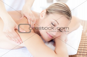Beautiful woman receiving a back massage