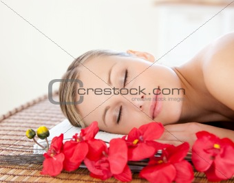 Beautiful woman relaxing in a Spa center