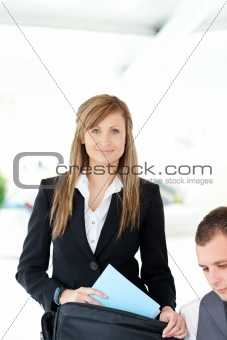 Beautiful businesswoman preparing her briefcase